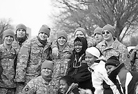 US troops and spectators pose for photos the day before the inauguration of Barack Obama as 44th President of the United States of America, Monday, Jan. 19, 2009, in Washington, D.C. (Marisa McGrody/pressphotointl.com)