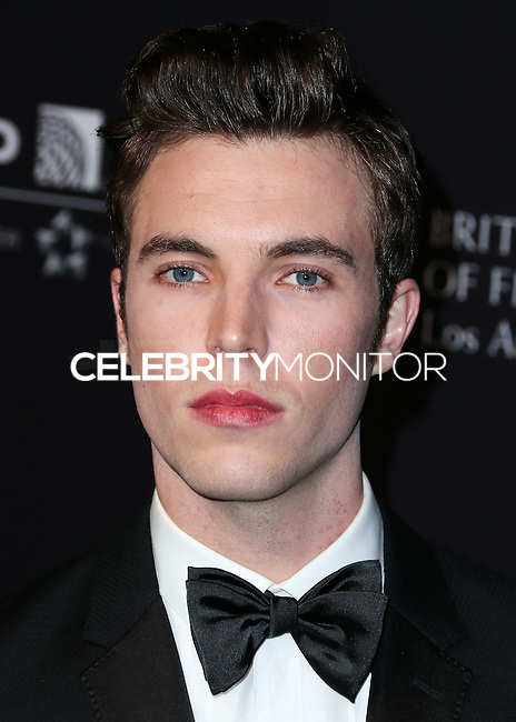 BEVERLY HILLS, CA, USA - OCTOBER 30: Tom Hughes arrives at the 2014 BAFTA Los Angeles Jaguar Britannia Awards Presented By BBC America And United Airlines held at The Beverly Hilton Hotel on October 30, 2014 in Beverly Hills, California, United States. (Photo by Xavier Collin/Celebrity Monitor)