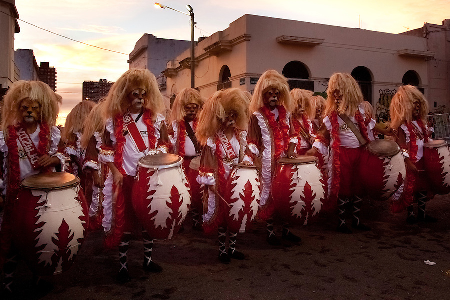 A drum battery lines up to perform in the parade of Llamadas during Carnaval in Montevideo, Uruguay.