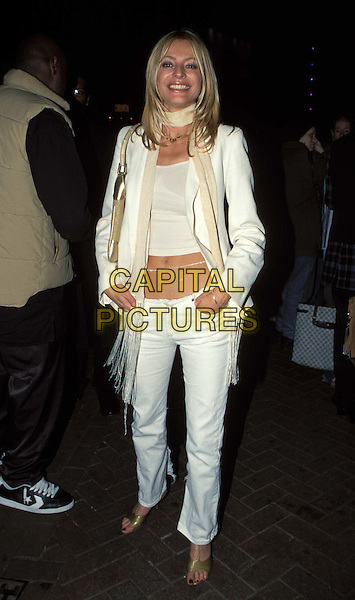 TESS DALEY - TESS DALY..Ref:10397..sales@capitalpictures.com..www.capitalpictures.com..©Capital Pictures..gold sandals, white trousers, cream scarf, white top, midriff, stomach, belly chain, white jacket, white blazer, hands in pockets, gold bag, gold purse, smiling