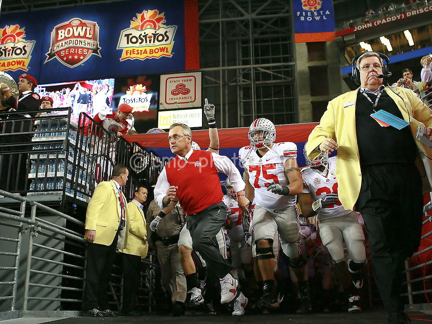 Jan 05, 2009; Glendale, AZ, USA; Ohio State Buckeyes head coach Jim Tressel leads offensive tackle Alex Boone (75) and the rest of the Buckeyes on to the field prior to the Fiesta Bowl against the Texas Longhorns at University of Phoenix Stadium.  The Longhorns won the game 24-21.