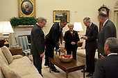 Washington, DC - October 22, 2009 -- United States President Barack Obama takes an apple from a bowl prior to meeting with, from left, U.S. Senator Dick Durbin (Democrat of Illinois), U.S. Senator Patty Murray (Democrat of Washington), U.S. Senate Majority Leader Harry Reid (Democrat of Nevada), and U.S. Senator Charles Schumer (Democrat of New York), in the Oval Office, October 22, 2009. .Mandatory Credit: Pete Souza - White House via CNP
