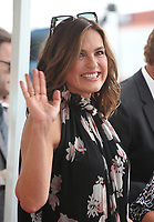 HOLLYWOOD, CA - OCTOBER 6: Mariska Hargitay pictured as Debra Messing is Honored With A Star On The Walk Of Fame on Hollywood Boulevard in Hollywood, California on October 6, 2017. <br /> CAP/MPI/FS<br /> &copy;FS/MPI/Capital Pictures