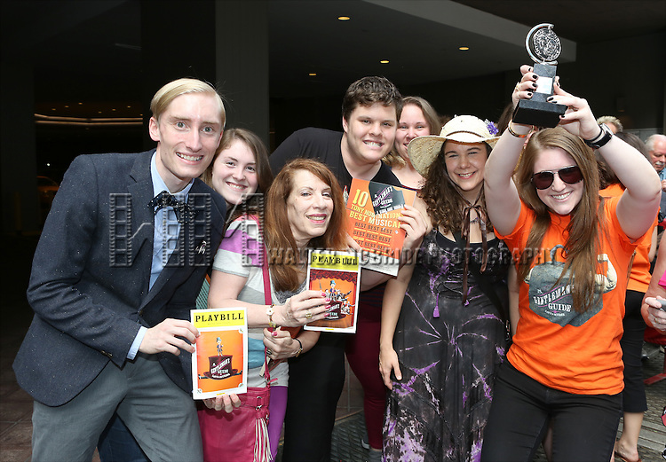 Fans  during the cast and fan Tony Award celebration outside 'A Gentleman's Guide to Love and Murder'  at Walter Kerr Theatre on June 18, 2014 in New York City..