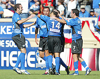 24 October 2004: (from left to right) Ryan Cochrane, Ramiro Corrales, Dwayne De Rosario and Ian Russell celebrate with Rosario after Rosario scored a goal in the first half of the game against Wizards at Spartan Stadium in San Jose, California.   Earthquakes defeated Wizards, 2-0.  Credit: Michael Pimentel / ISI