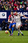 Yannick Ferreira Carrasco of Atletico de Madrid fights for the ball with Daniel Carvajal Ramos of Real Madrid during their La Liga match between Atletico de Madrid and Real Madrid at the Vicente Calderón Stadium on 19 November 2016 in Madrid, Spain. Photo by Diego Gonzalez Souto / Power Sport Images