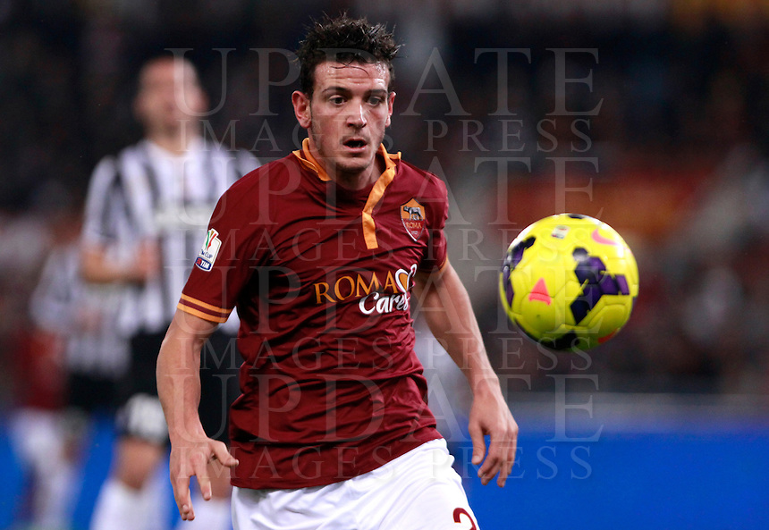 Calcio, quarti di finale di Coppa Italia: Roma vs Juventus. Roma, stadio Olimpico, 21 gennaio 2014.<br /> AS Roma midfielder Alessandro Florenzi eyes the ball during the Italian Cup round of eight final football match between AS Roma and Juventus, at Rome's Olympic stadium, 21 January 2014.<br /> UPDATE IMAGES PRESS/Isabella Bonotto