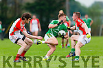 Adam Barry St Kieran's through the Kilcummin defence during their County Championship clash in Kilcummin on Saturday