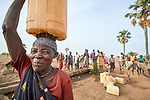 A woman carries water from a well in Lugi, a village in the Nuba Mountains of Sudan. The area is controlled by the Sudan People's Liberation Movement-North, and frequently attacked by the military of Sudan.