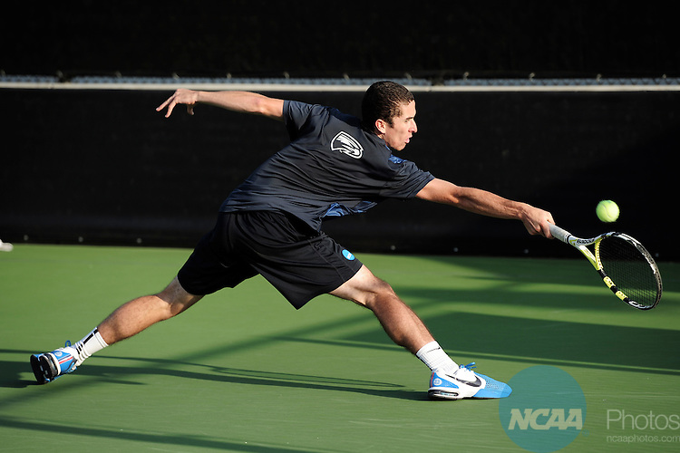 26 MAY 2011: Simon Lavoie-Perusse of Emory returns a volley during the Division III Men's Tennis Championship held at the Biszantz Family Tennis Center and Pauley Tennis Complex in Claremont, CA. Amherst defeated Emory 5-2 for the national title. Stephen Nowland/NCAA Photos