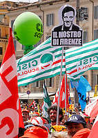 "Manifestazione sindacale in occasione dello sciopero contro la riforma della ""Buona Scuola"" a Roma, 5 maggio 2015.<br /> Italian unions demonstrate on the occasion of the strike against the government's school reform, in Rome, 5 May 2015. The sign at top, portraying Italian Premier Matteo Renzi, reads 'The monster of Florence'.<br /> UPDATE IMAGES PRESS/Riccardo De Luca"