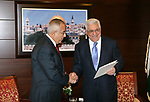 (FILES) This file photo taken on February 14, 2011 shows Palestinian Prime Minister Salam Fayyad as he submits his government's resignation to Palestinian President Mahmoud Abbas in Abbas' offices in the West Bank town of Ramallah. According to media, a sudden meeting was held between Palestinian President Mahmoud Abbas and former Palestinian Prime Minister Salam Fayyad, before days ago, in the West Bank city of Ramallah. Photo by Thaer Ganaim