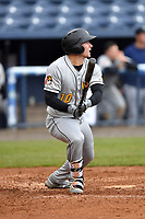 West Virginia Power center fielder Jarred Kelenic (10) swings at a pitch during game two of a double header against the Asheville Tourists at McCormick Field on April 20, 2019 in Asheville, North Carolina. The Power were leading the Tourists 6-0 when the game was suspended in the middle of the fourth inning. (Tony Farlow/Four Seam Images)
