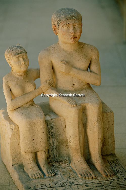 Painted limestone pair statue of Ipsekh and Henus, husband and wife, Old Kingdom
