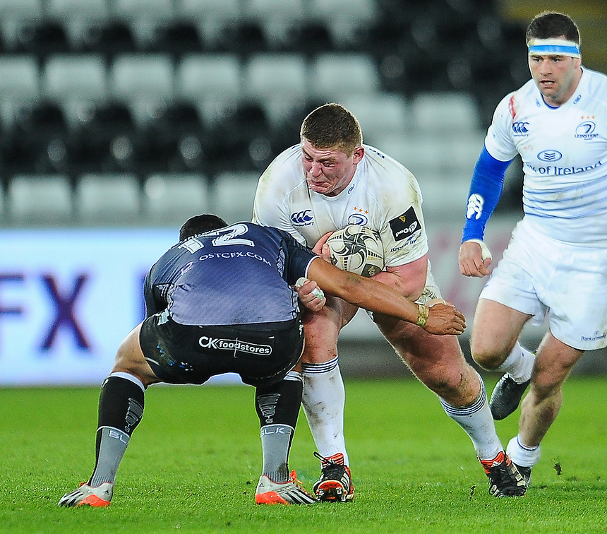 Leinster's Tadhg Furlong is tackled by  Ospreys' Josh Matavesi<br /> <br /> Photographer Craig Thomas/CameraSport<br /> <br /> Rugby Union - Guinness PRO12 - Ospreys V Leinster - Friday 27th February 2015 - Liberty Stadium - Swansea<br /> <br /> &copy; CameraSport - 43 Linden Ave. Countesthorpe. Leicester. England. LE8 5PG - Tel: +44 (0) 116 277 4147 - admin@camerasport.com - www.camerasport.com