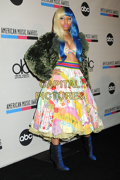 Nicki Minaj.2011 American Music Awards Nominee Press Conference held at the JW Marriott LA Live Hotel, Los Angeles, California, USA..October 11th, 2011.full length green jacket seaweed cabbage food cropped top bra bathing suit cleavage green skirt belly stomach midriff blue blonde hair dyed print floral black boots hand on hip.CAP/ADM/BP.©Byron Purvis/AdMedia/Capital Pictures.