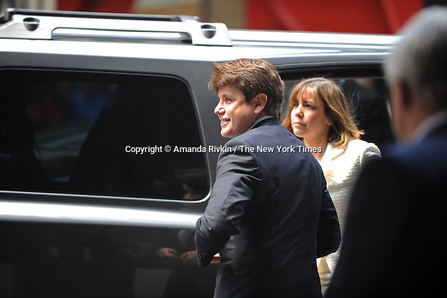 Former Illinois Governor Rod Blagojevich arrives with his wife Patti Blagojevich at the Dirksen Federal Building to hear the verdict in his retrial on corruption charges in Chicago, Illinois on June 27, 2011.