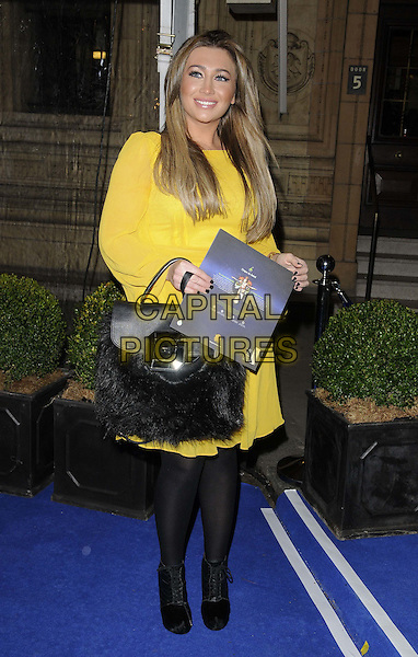 Lauren Goodger.'Cirque Du Soleil: Totem' UK Premiere, Royal Albert Hall, London, England..5th January 2012.full length yellow dress black tights fur  .CAP/CAN.©Can Nguyen/Capital Pictures.
