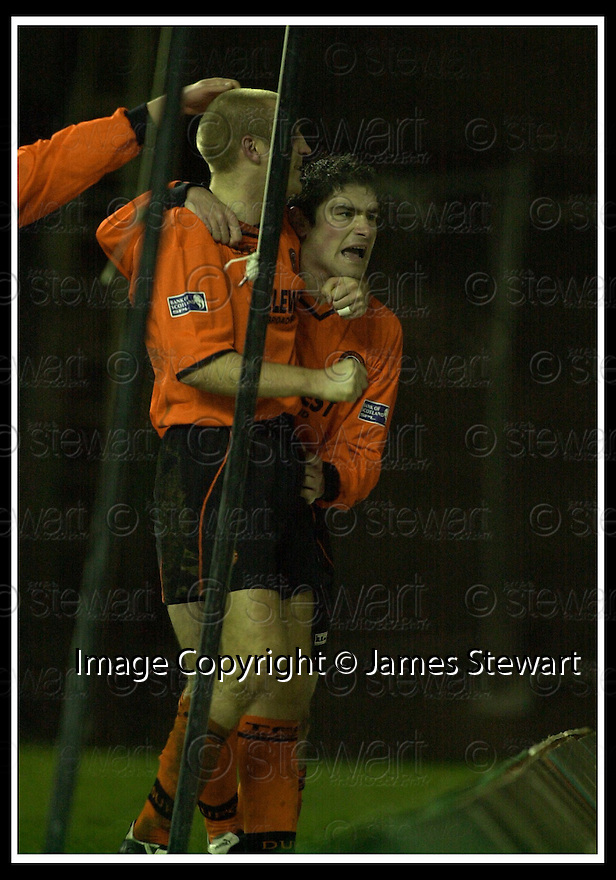 02/01/2002                 Copyright Pic : James Stewart .Ref :     .File Name : stewart-hibs v dundee utd 09.JAMES PATERSON (RIGHT) IS CONGRTULATEFD BY JIM HAMILTON AFTER SCORING UNITED'S GOAL...James Stewart Photo Agency, Stewart House, Stewart Road, Falkirk. FK2 7AS      Vat Reg No. 607 6932 25.Office     : +44 (0)1324 630007     .Mobile  : + 44 (0)7721 416997.Fax         :  +44 (0)1324 630007.E-mail  :  jim@jspa.co.uk.If you require further information then contact Jim Stewart on any of the numbers above.........