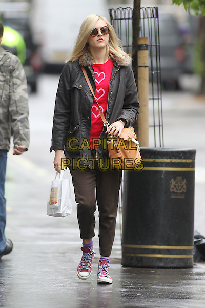 Fearne Cotton in central London, England..July 4th, 2012.full length sunglasses shades black jacket red pink hearts print top brown trousers converse trainers sneakers brown leather satchel bag  fur collar.CAP/HIL.©John Hillcoat/Capital Pictures.