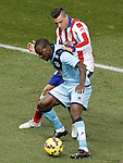 Atletico de Madrid's Jose Maria Gimenez (t) and Rayo Vallecano's Gael Kakuta during La Liga match.January 24,2015. (ALTERPHOTOS/Acero)
