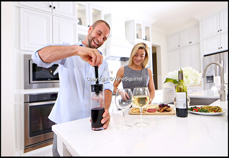BNPS.co.uk (01202 558833)<br /> Pic: WineSquirrel/BNPS<br /> <br /> Wine lovers are celebrating after a device was invented that promises to keep plonk fresh for up to three weeks after it has been opened.<br /> <br /> As soon as wine comes into contact with oxygen it starts to spoil, and the contents of many a bottle has been thrown away after it went off before it could be drunk.<br /> <br /> But British brothers Maurice and Tom Gonsalves say their nifty creation, called Wine Squirrel, allows drinkers to enjoy one or two glasses at a time by creating an airtight seal over the wine, thus putting an end to wasted wine for good.