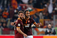 Calcio, Serie A: Roma vs ChievoVerona. Roma, stadio Olimpico, 31 ottobre 2013.<br /> AS Roma midfielder Daniele De Rossi, left, and defender Mehdi Benatia, of Morocco, celebrate at the end of the Italian Serie A football match between AS Roma and ChievoVerona at Rome's Olympic stadium, 31 October 2013. AS Roma won 1-0.<br /> UPDATE IMAGES PRESS/Riccardo De Luca