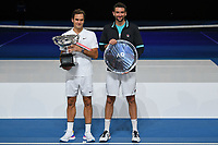 January 28, 2018: Number two seed Roger Federer of Switzerland and  number six seed Marin Cilic of Croatia pose for photographs after Federer won the Men's Final against on day fourteen of the 2018 Australian Open Grand Slam tennis tournament in Melbourne, Australia. Federer won 3 sets to 2. Photo Sydney Low