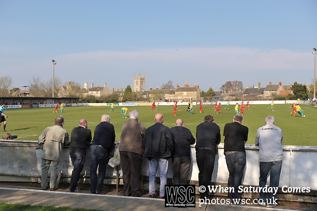 Stamford AFC 2 Marine 4, 29/03/2014. Wothorpe Road, Northern Premier League. Supporters watch The Northern Premier League game between Stamford AFC and Marine from The Daniels Stadium. Marine won the game 4-2 in front of 320 supporters to boost their chances of relegation survival. Stamford AFC are moving to the brand new Zeeco Stadium at the end of the 2013/14 season Photo by Simon Gill.