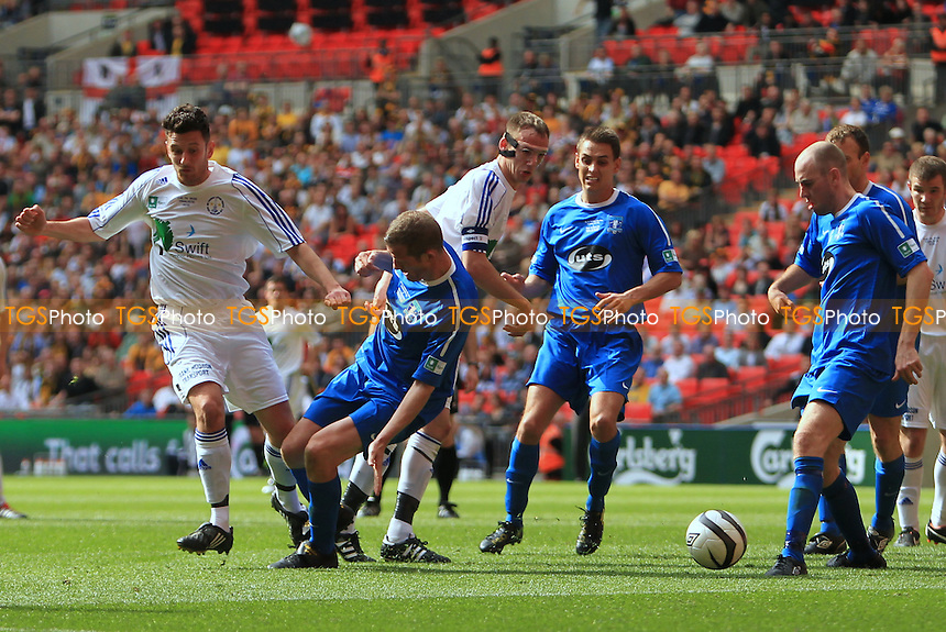 Martin Young strikes through the legs of a Dunston defender - Dunston UTS vs West Auckland Town - FA Challenge Vase Final at Wembley Stadium, London - 13/05/12 - MANDATORY CREDIT: Simon Roe/TGSPHOTO - Self billing applies where appropriate - 0845 094 6026 - contact@tgsphoto.co.uk - NO UNPAID USE.