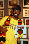 Shane W. Evans (illustrator of the book - Chocolate Me!) joins with fans at  launch party to celebrate their first picture book together on September 28, 2011 at Books of Wonder, New York City, New York. Shane W. Evans on his guitar.  (Photo by Sue Coflin/Max Photos)