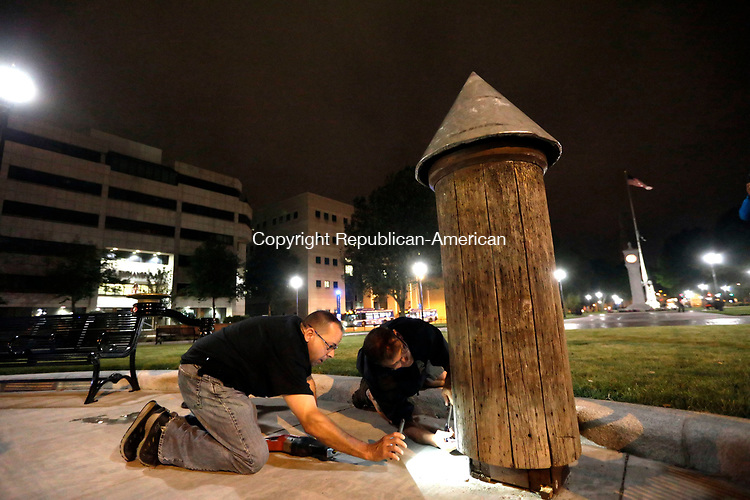 Waterbury, CT- 27 July 2017-072717CM03-   Waterbury Department of Public Works employees remove a post on the City green on Thursday night.  The post which has caused controversy in recent time was removed and taken away from the green.        Christopher Massa Republican-American