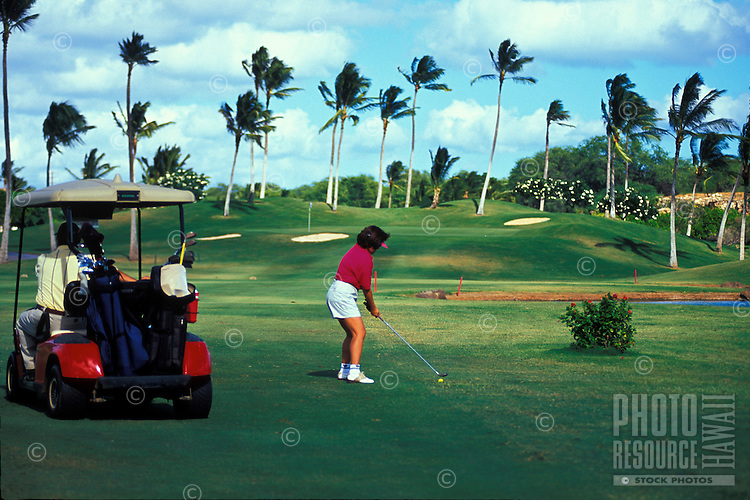 Local residents play a round of gofl at the Ko Olina course on west Oahu