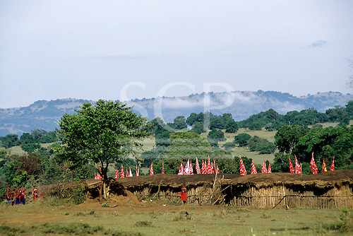 Lolgorian, Kenya. Siria Maasai Manyatta circular temoporary village set up for the eunoto coming of age ceremony with flags.