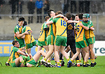 Inagh-Kilnamona players celebrate in the rain  following their Minor A county final win over Kilmaley at Cusack Park. Photograph by John Kelly.