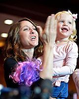 NWA Democrat-Gazette/BEN GOFF -- 04/26/15 Emily Arey with daughter Reese Arey, 2, blows a kiss to husband Matt Arey, FLW pro from Shelby, N.C., after he was announced as the winner of the Walmart FLW Tour at Beaver Lake at the John Q. Hammons Center in Rogers on Sunday Apr. 26, 2015. Arey won the event for the second year in a row with a four-day total of 55 lbs. 6 oz.