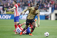 Atletico de Madrid´s Arda Turan (R) and Gabi and Milan´s Balotelli during 16th Champions League soccer match at Vicente Calderon stadium in Madrid, Spain. January 06, 2014. (ALTERPHOTOS/Victor Blanco)