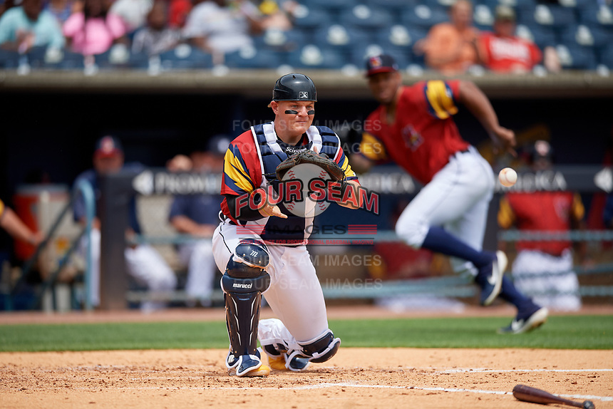 Toledo Mud Hens catcher Kade Scivicque (4) fields a throw during an International League game against the Durham Bulls on July 16, 2019 at Fifth Third Field in Toledo, Ohio.  Durham defeated Toledo 7-1.  (Mike Janes/Four Seam Images)