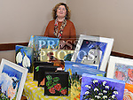 Kate Tallon with some of her art work at the new Drogheda market held in St. Peter's Parish hall. Photo:Colin Bell/pressphotos.ie