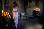 Holywell gypsy girl lights candles at Annual Gypsies gathering on the feast day of 22 June at St Winefrides Shrine Holywell Flintshire Wales St Winifred or Saint Winefride was a 7th-century Welsh Christian  woman, around whom many historical legends have formed. A healing spring at the traditional site of her death is now a shrine and pilgrimage site called St Winefrifdes Well,  known as the Lourdes of Wales.