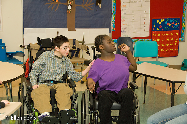 MR / Albany.Langan School at Center for Disability Services (private nonprofit disability services).Upper elementary classroom/Day Program.Students interact as boy talks to and gently touches girl. Boy: 11, cerebral palsy, expressive and receptive language delays; Girl: 10, African-American, cerebral palsy, expressive and receptive language delays.MR: Bro12, And6.© Ellen B. Senisi
