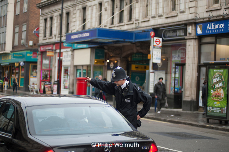 Metropolitan Police Constable deals with motorists, Paddington.