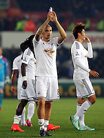 Pictured: Jonjo Shelvey of Swansea applauds home supporters after the final whistle. Tuesday 23 September 2014<br /> Re: Capital One Cup, Swansea City FC v Everton at the Liberty Stadium, south Wales, UK