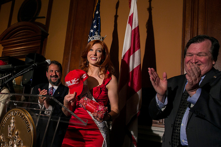"UNITED STATES - August 27: Haely Jardas, Miss District of Columbia for 2015, is cheered on as she receives a ""Free DC"" hat, in support of the District of Columbia receiving statehood, during Jardas' send off at the John A. Wilson Building in Washington, on Thursday, August 27, 2015. Jardas leaves Sunday for Atlantic City where she will compete for the Miss America 2016 title in September. (Photo By Al Drago/CQ Roll Call)"