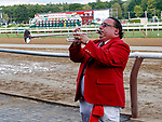 "Sam ""The Bugler"" Grossman plays an extended seranade for the crowd in his final call to the post at Saratoga Race Course, Sep. 3, 2018.    This final call, as the Saratoga meet ends, marks the retirement of Grossman after 25 years of service.  (Bruce Dudek/Eclipse Sportswire)"