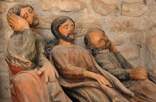 Apostles Peter, James and John sitting and sleeping, carved wooden  sculpture group of the Agony (detail), 17th century, Benedictine Abbey of Saint Michel de Cuxa, Codalet, Pyrenees Orientales, France. Picture by Manuel Cohen