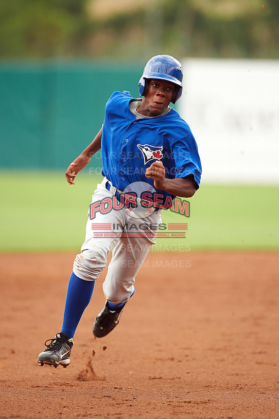 Errol Robinson #7 of St. Johns College High School in Boyds, Maryland playing for the Toronto Blue Jays scout team during the East Coast Pro Showcase at Alliance Bank Stadium on August 1, 2012 in Syracuse, New York.  (Mike Janes/Four Seam Images)