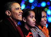 United States President Barack Obama, left, daughter Malia, center, and first lady Michelle Obama, right, participate in the 2011 National Christmas Tree Lighting on the Ellipse in Washington, DC, on Thursday, December 1, 2011.   .Credit: Roger L. Wollenberg / Pool via CNP