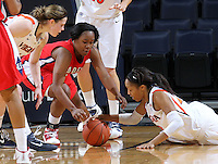 Dec. 6, 2010; Charlottesville, VA, USA; Radford Highlanders guard Denay Wood (11) reaches for a loose ball with Virginia Cavaliers guard Lexie Gerson (14) and Virginia Cavaliers guard Ataira Franklin (23) at the John Paul Jones Arena.  Mandatory Credit: Andrew Shurtleff