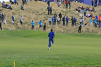 Rory McIlroy (Team Europe) running up the 18th fairway during the Sunday Singles of the Ryder Cup, Le Golf National, Ile-de-France, France. 30/09/2018.<br /> Picture Thos Caffrey / Golffile.ie<br /> <br /> All photo usage must carry mandatory copyright credit (© Golffile | Thos Caffrey)